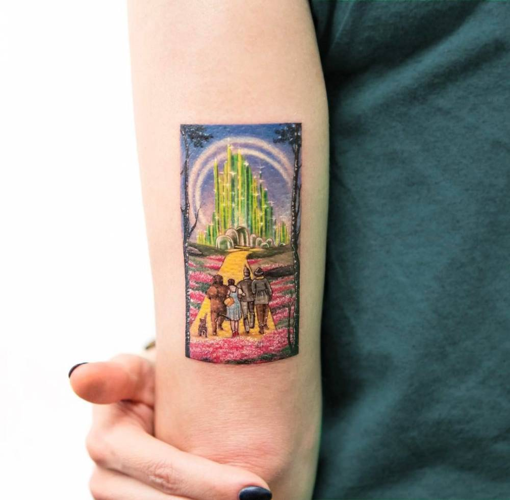 Wizard Of Oz Inspired Tattoo On The Back Of The Left