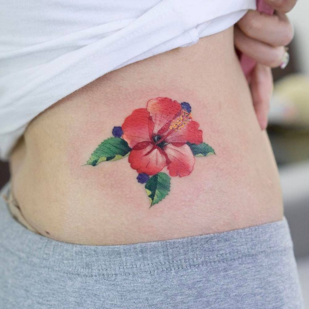 Red hibiscus flower tattoo on the hip izmirmasajfo