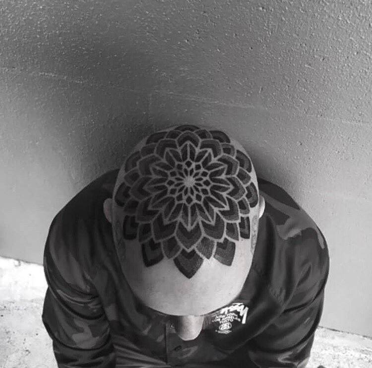 Head mandala tattoo.