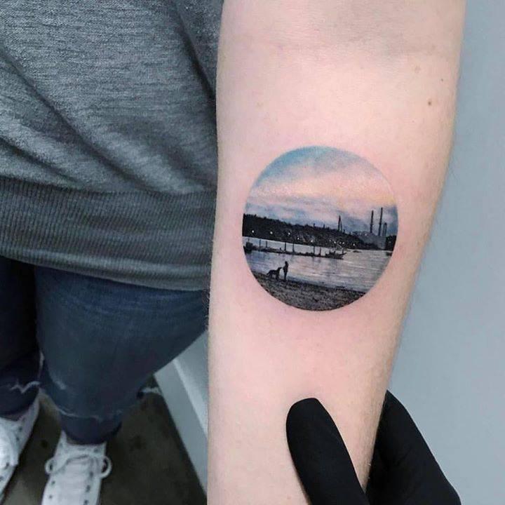 beach landscape circle tattoo on the left inner