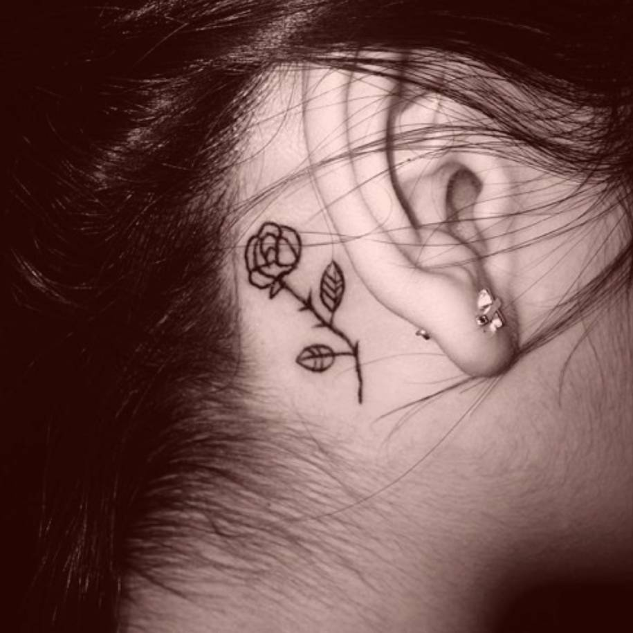Rose tattoo behind Victoria's ear.