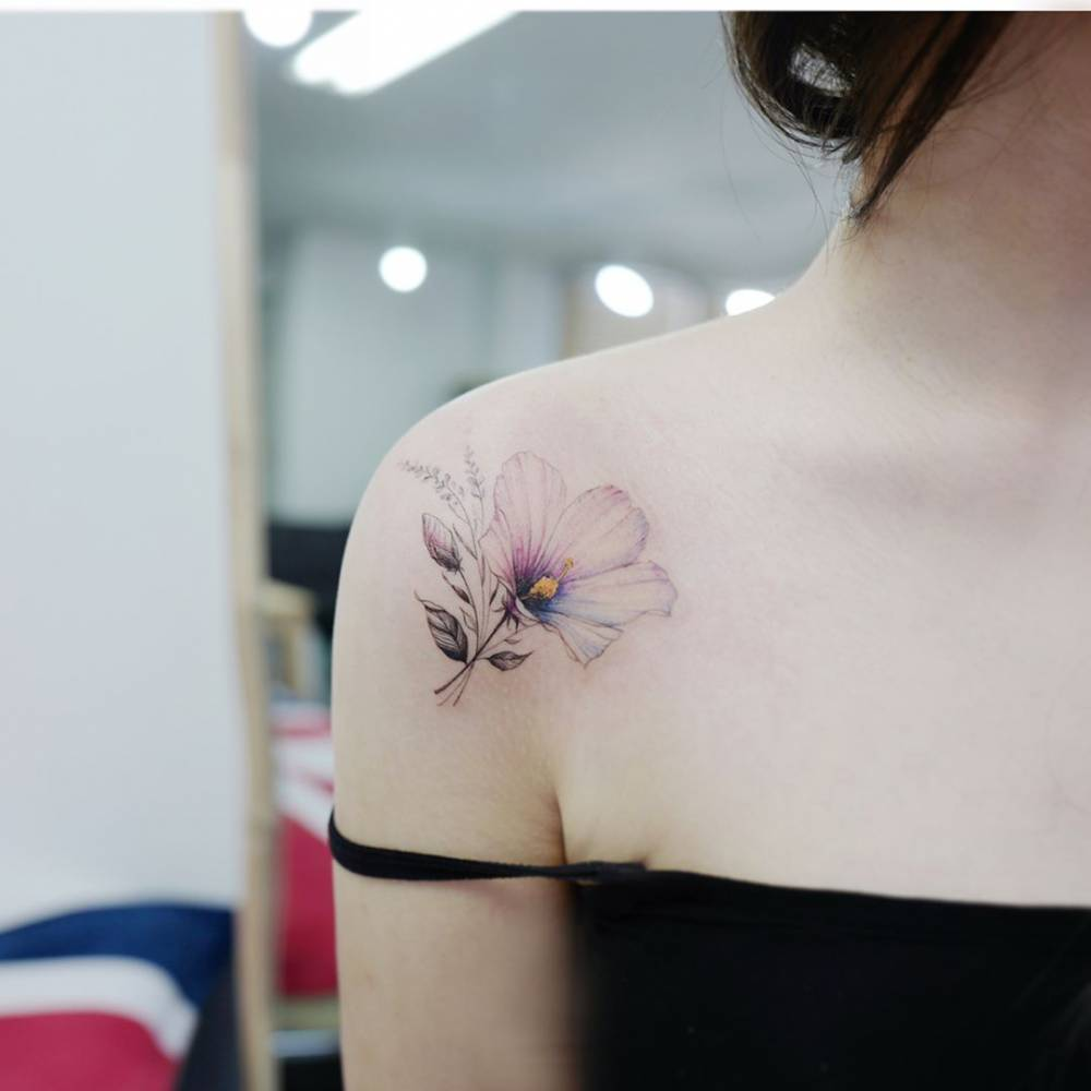Hibiscus flower tattoo on the right shoulder izmirmasajfo