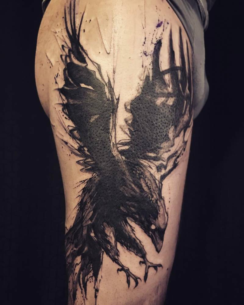 8698f809b Sketchy raven tattoo on the left upper arm.