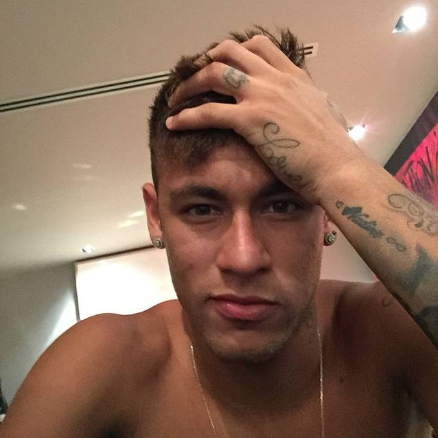"""The name of Neymar's mother, """"Nadine"""", tattooed on the outside of his left wrist, to which he later added a small heart and an infinity symbol, by  Adão Rosa. Hand tattoo saying """"Love"""", and a crown on his left ring finger."""