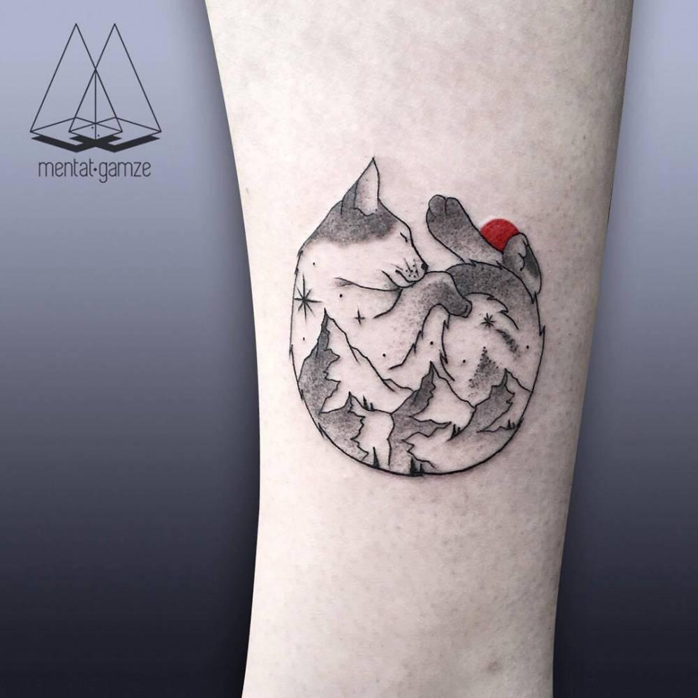 Double exposure cat mountain tattoo on the leg.