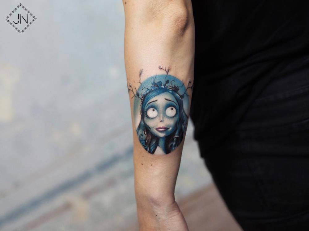 Corpse Bride's Victoria portrait tattoo on the left forearm.