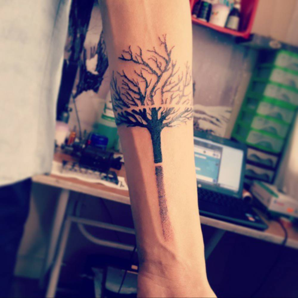 Forearm Tattoo Of A Tree And Two Lines On Martin