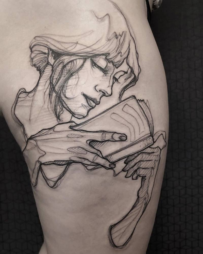 Woman reading a book tattoo in sketch work