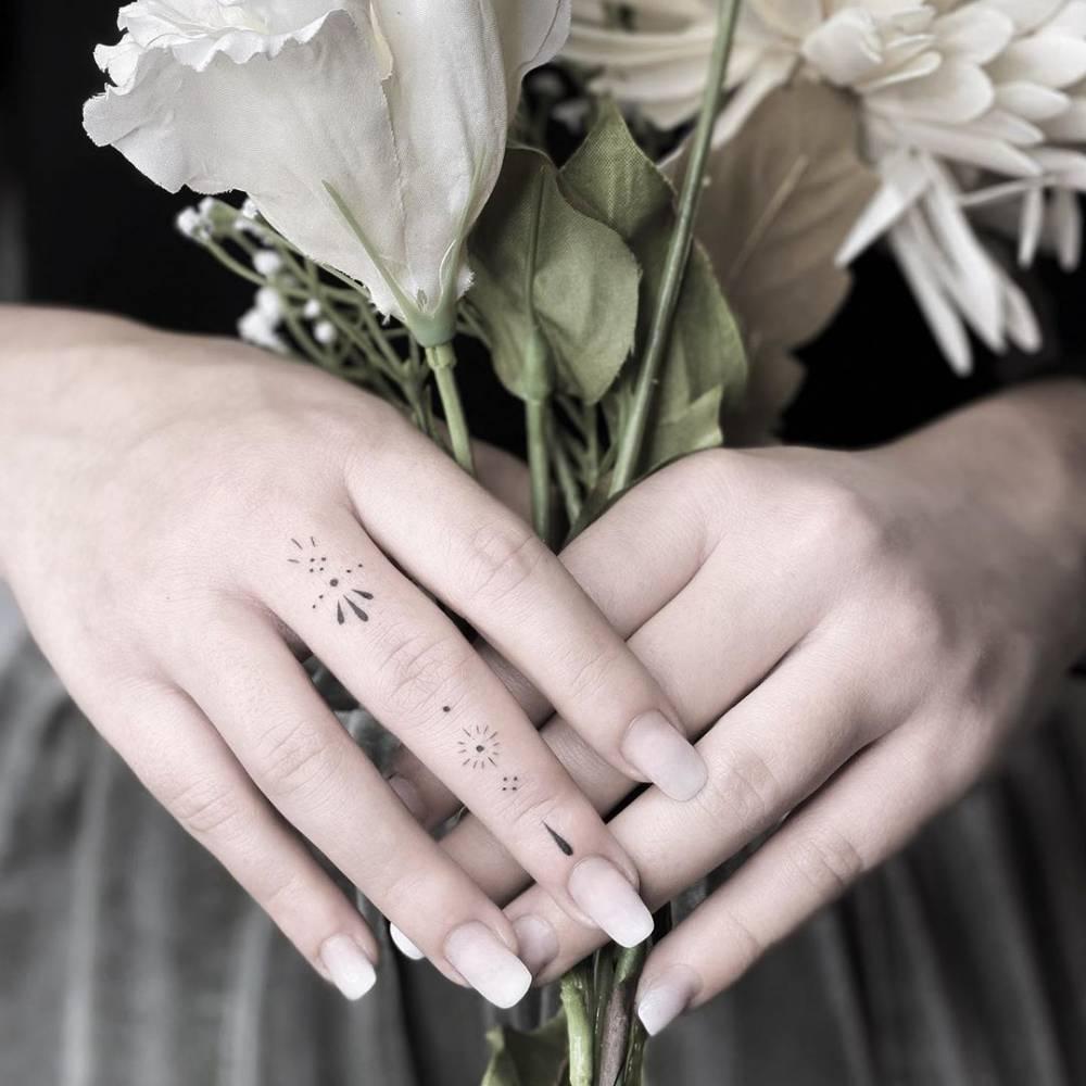 Ornamental finger tattoo