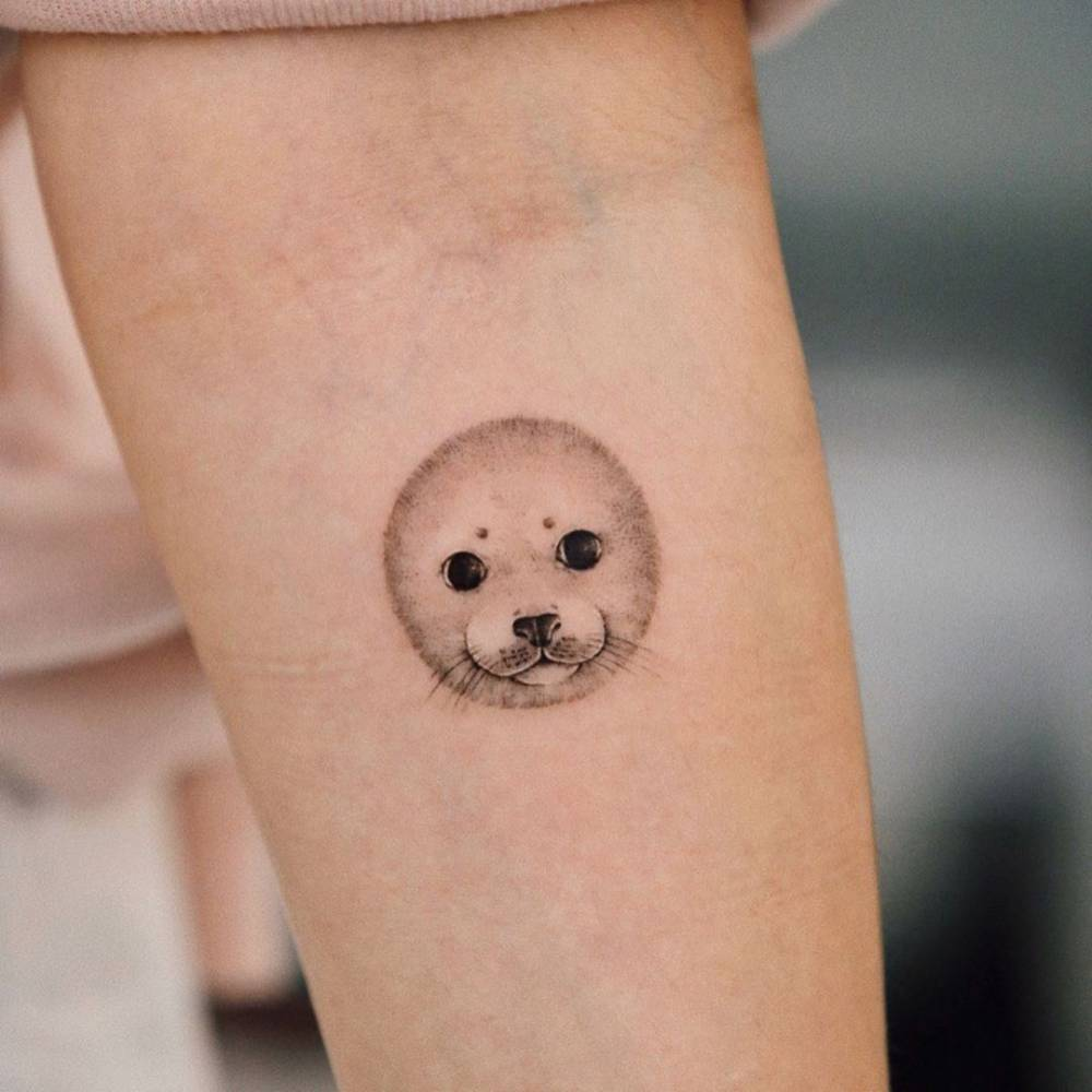 Micro-realist seal tattoo