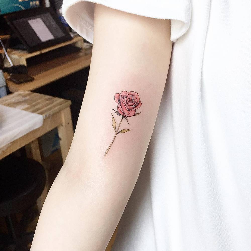 Red Rose Tattoo On The Right Inner Arm border=
