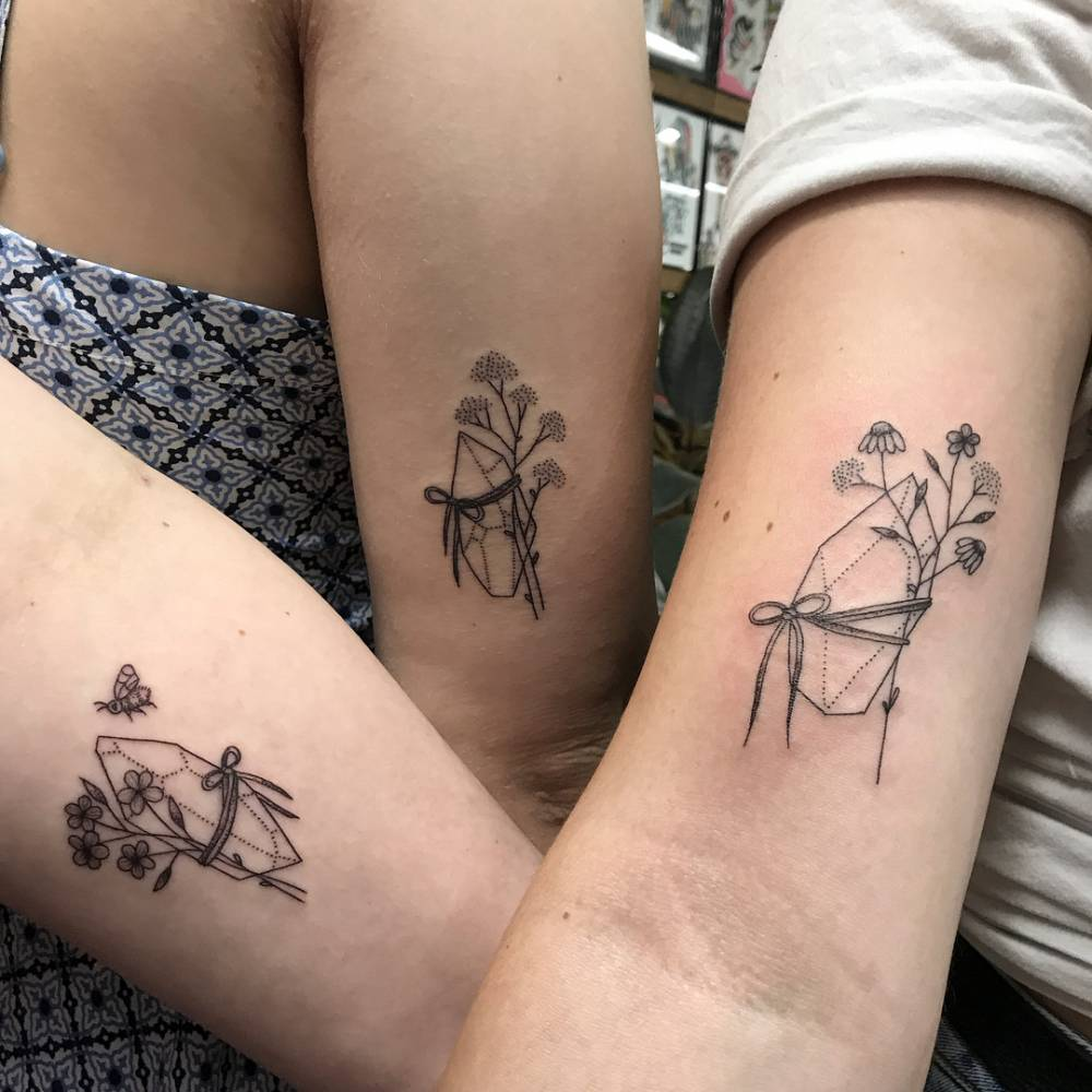 Matching tattoos on a mum and her daughters