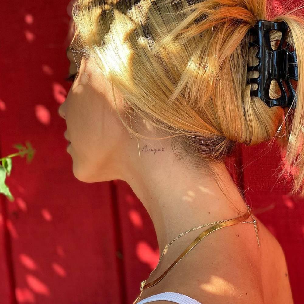 """Angel"" - lettering tattoo on Alexis Ren's neck"
