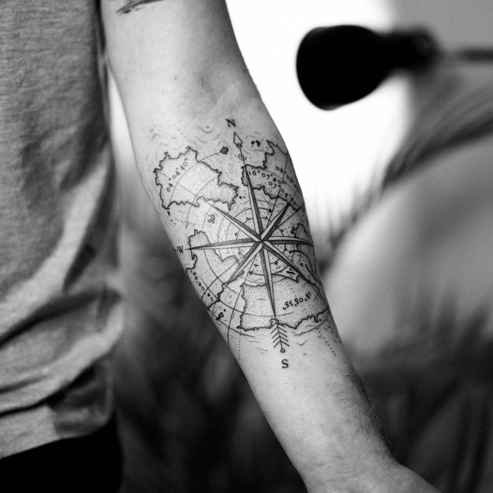 Compass rose and map tattoo