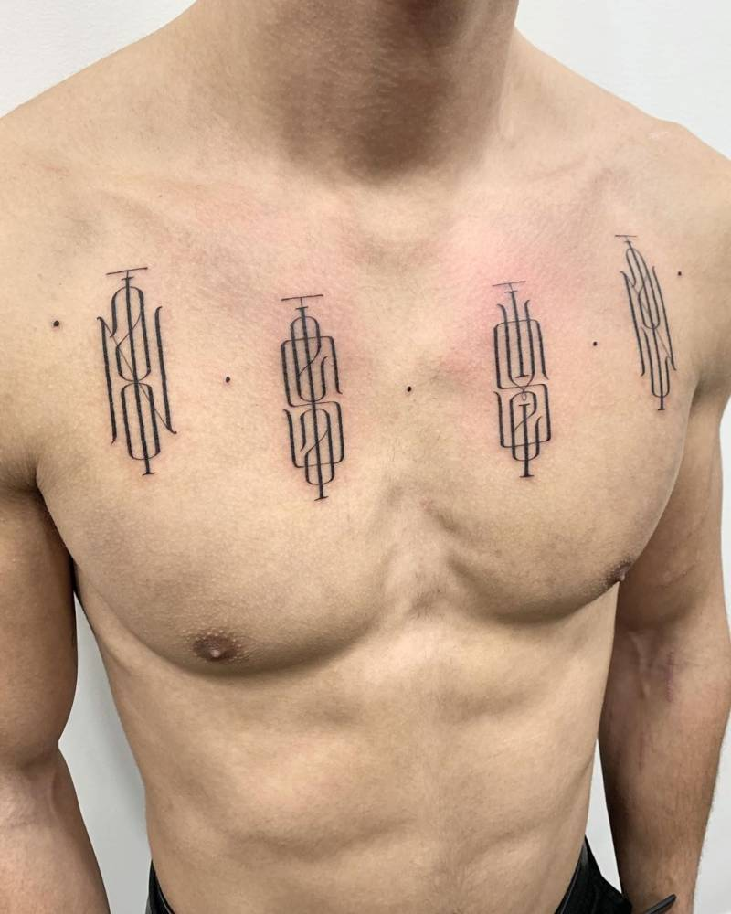Monogram tattoos on chest