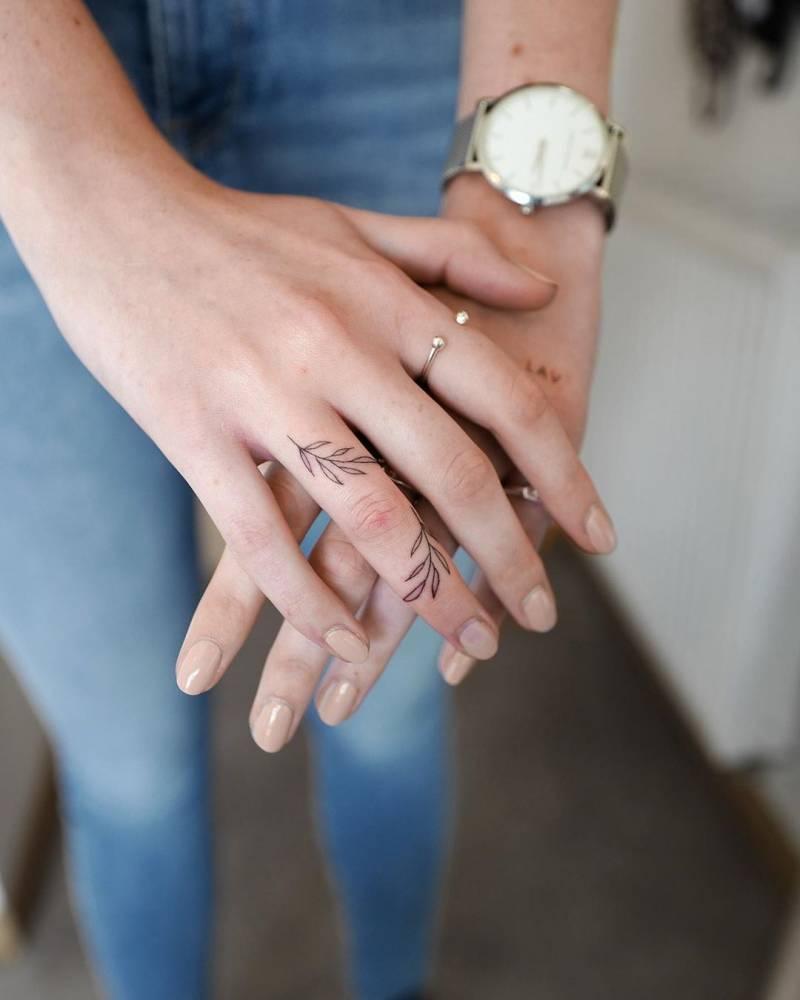 Minimalist Leaves Tattoo on Finger