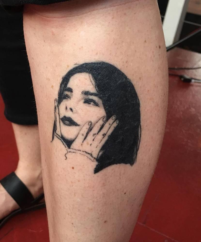 Healed Mini Björk Portrait Tattoo On The Shin