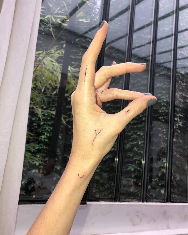 Lily Cole's Hand Tattoos