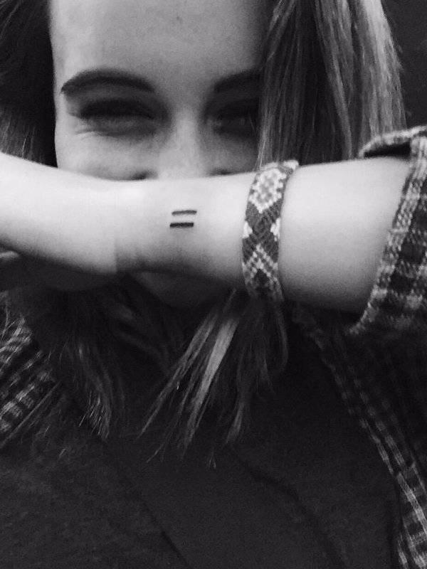 Equal sign tattoo on Bea Miller's left wrist.