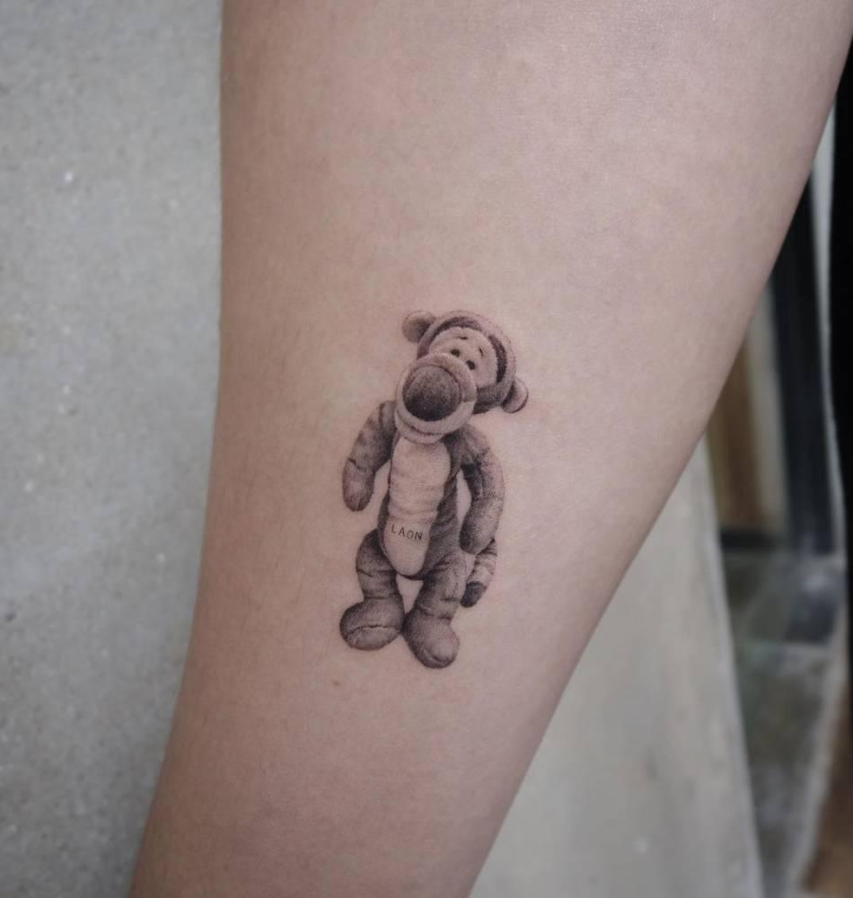 Micro-realist Tigger tattoo