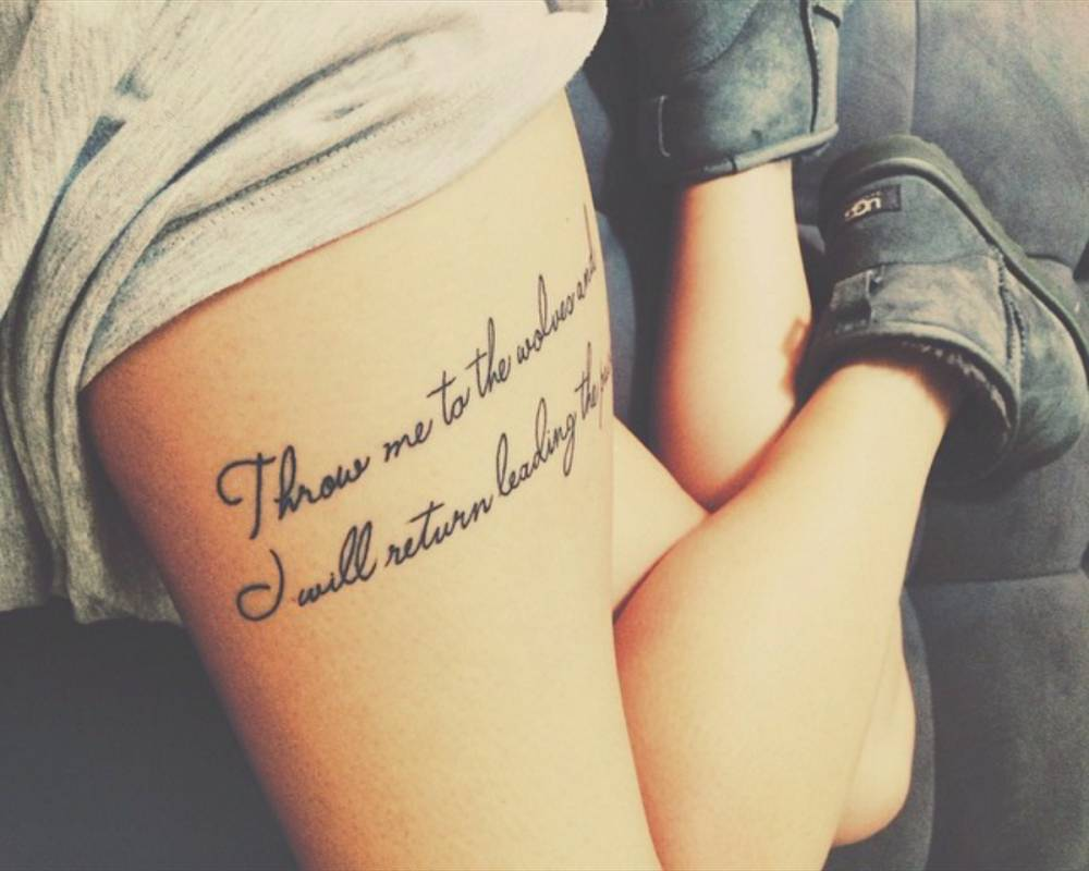Thigh Tattoo Saying Throw Me To The Wolves And I Will