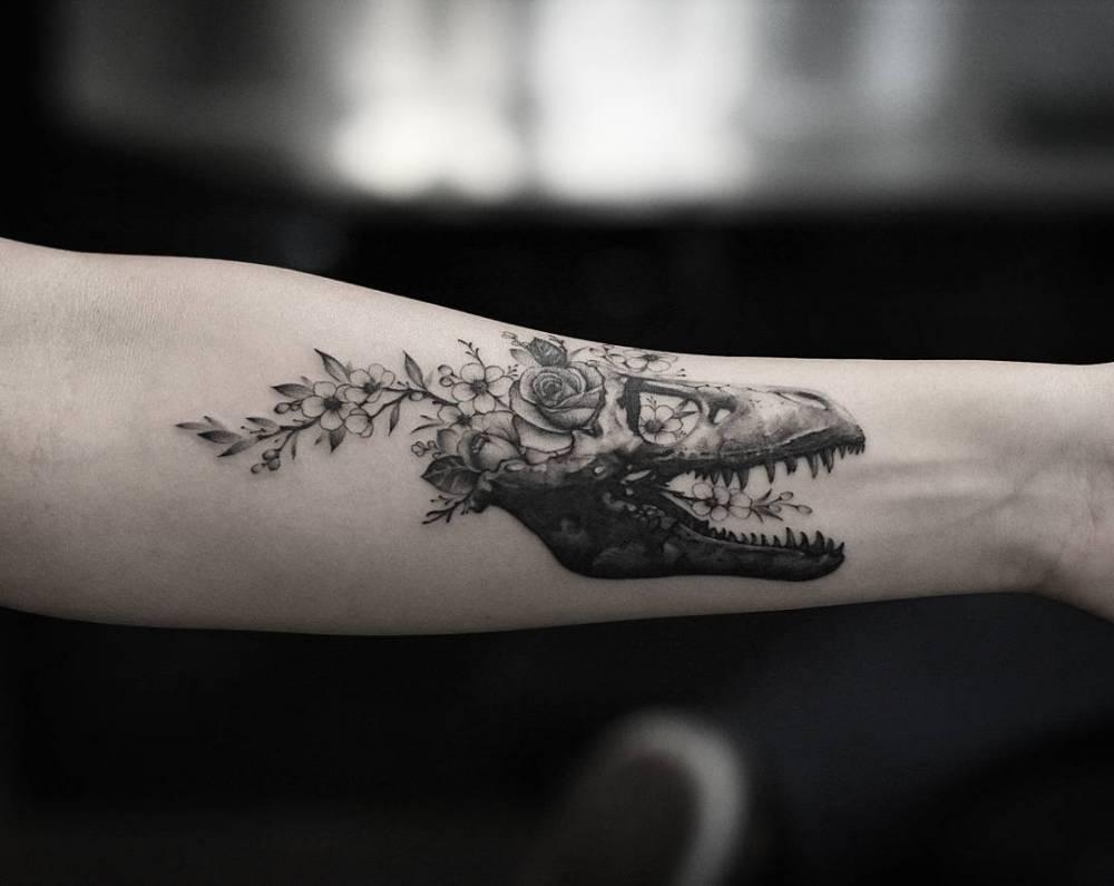 Floral T-Rex skull on the inner forearm.