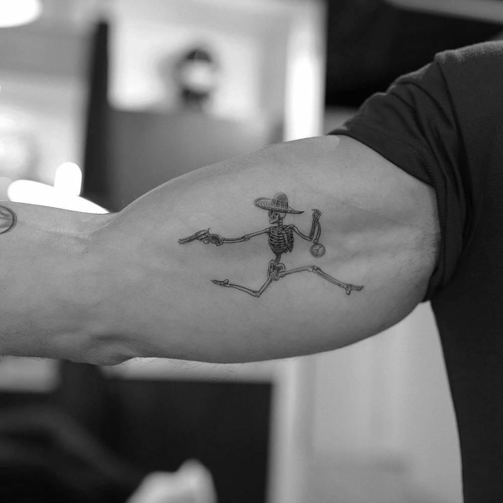 Skeleton tattoo on Mark Consuelos' inner arm
