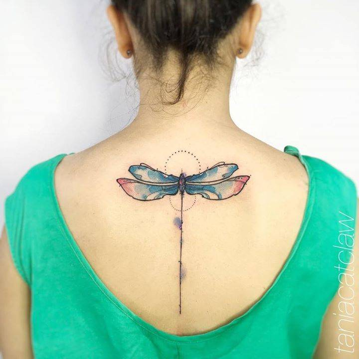 Sketch work dragonfly tattoo on the upper back.