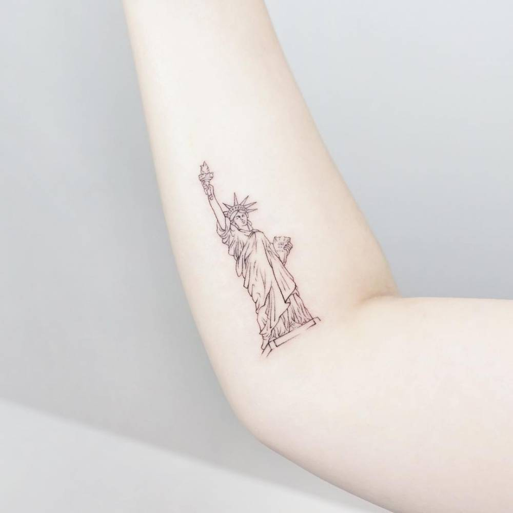 Statue Of Liberty Tattoo On The Right Inner Forearm