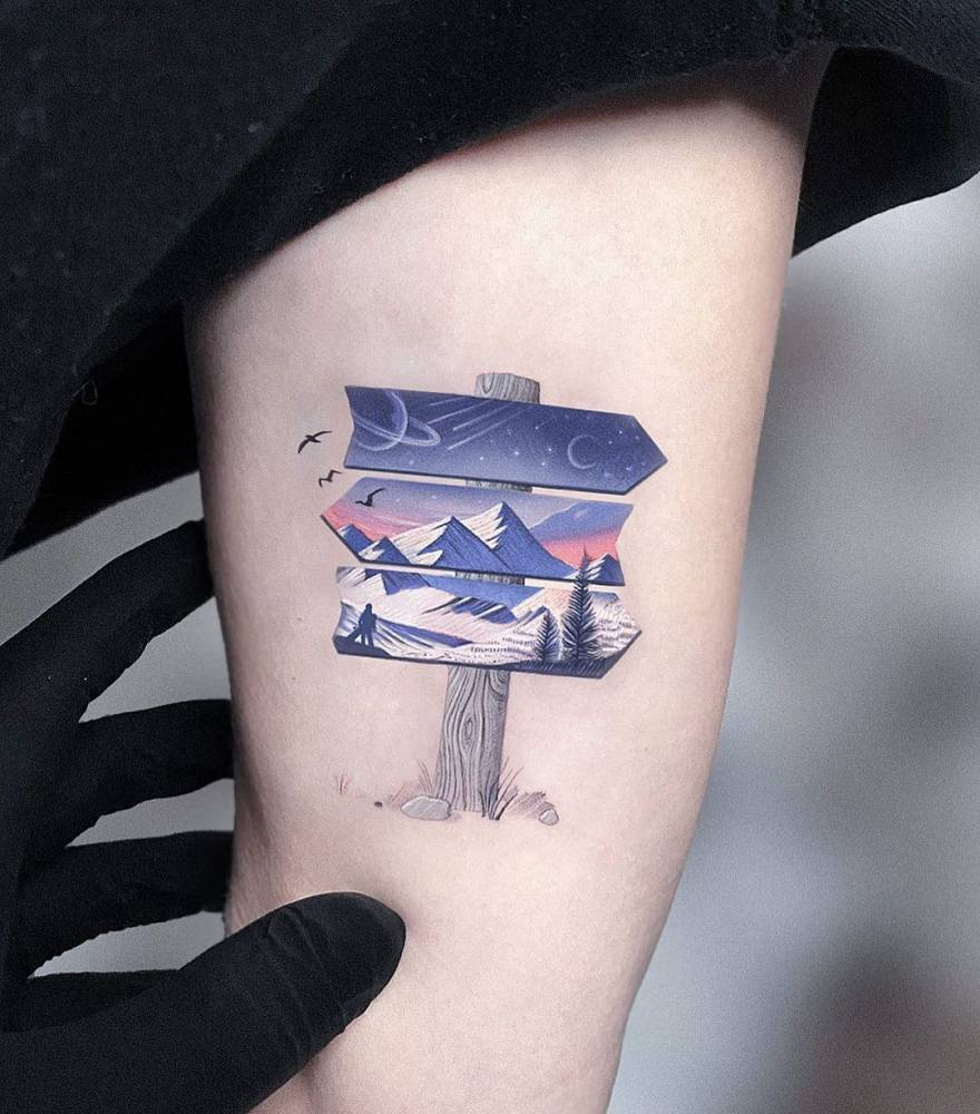 Micro-realistic signpost tattoo on the inner arm