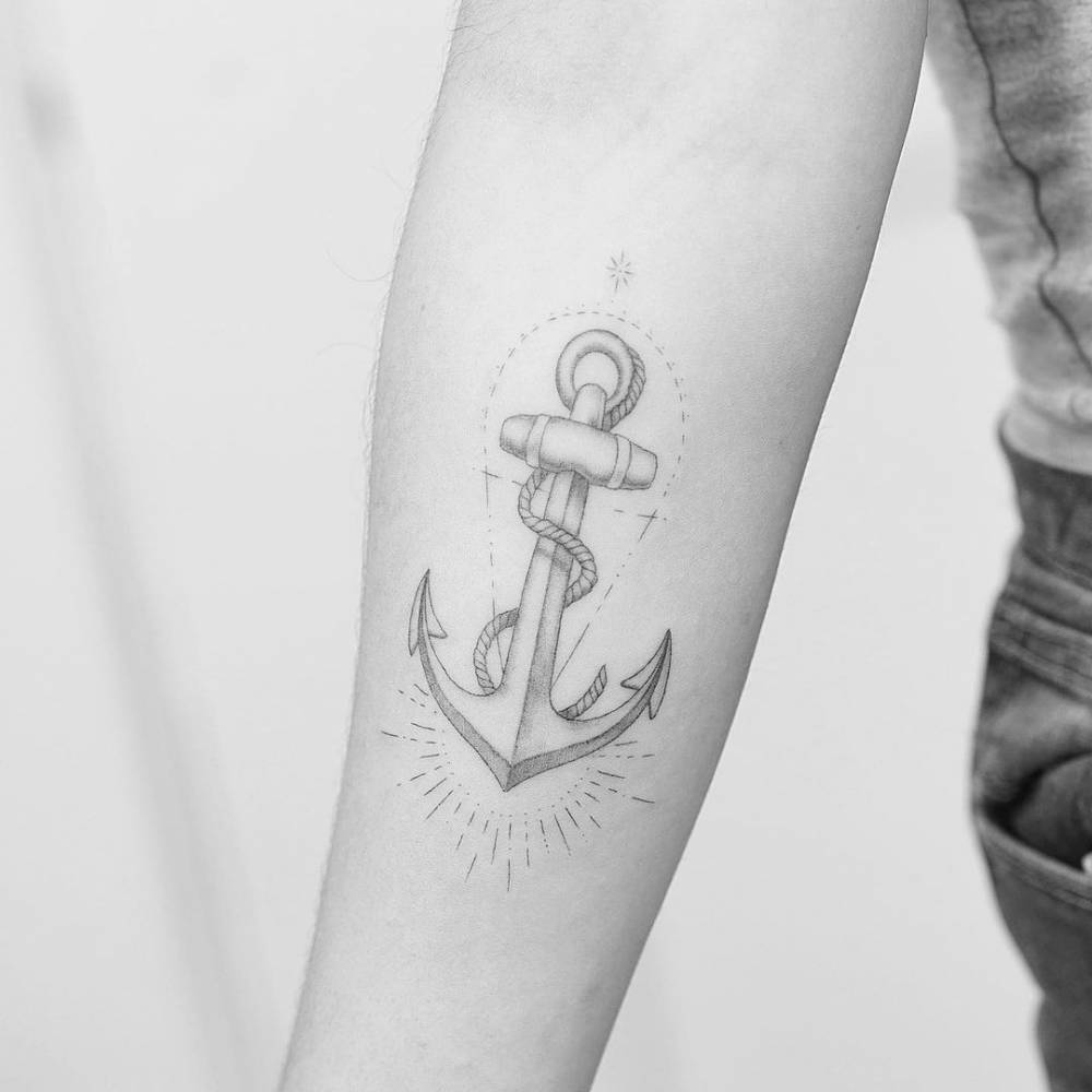 Fine line anchor tattoo on the inner forearm