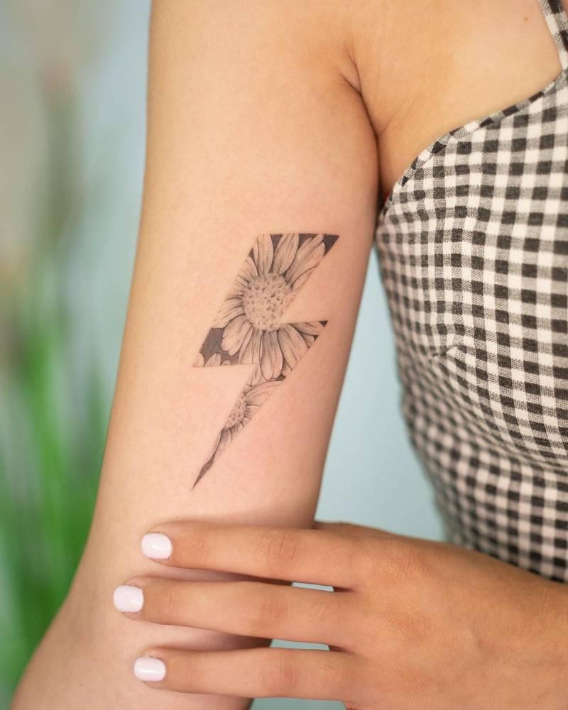 Lightning bolt sunflower tattoo on the inner arm