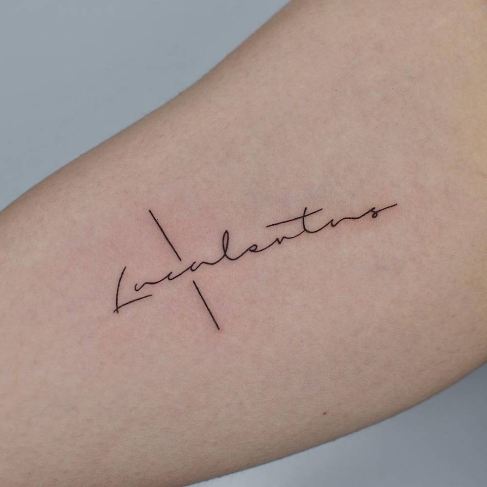 Lettering tattoo on the inner arm