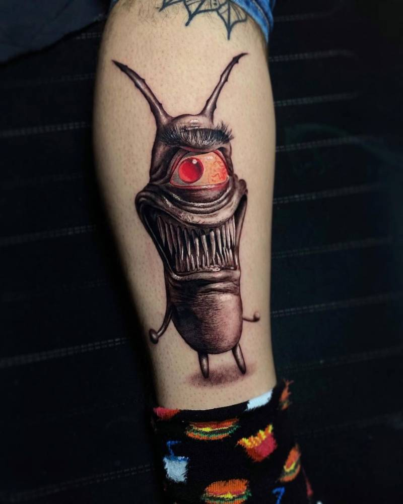 Realistic monster tattoo on the shin