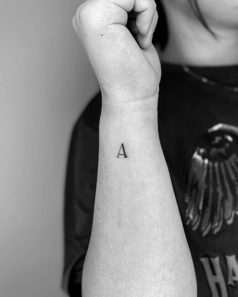 """Minimalist letter """"A"""" tattoo on the wrist"""