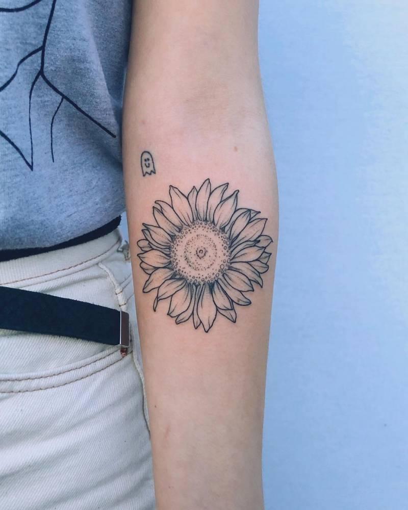 Sunflower tattoo on the inner forearm