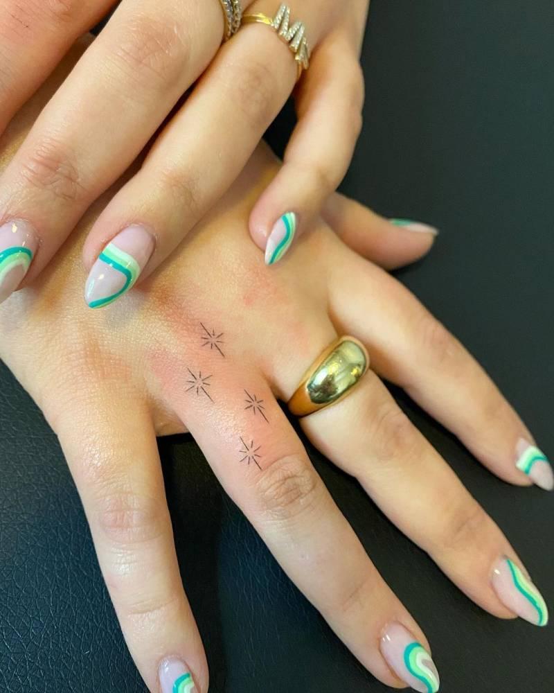 Minimalist north stars tattoo on the finger