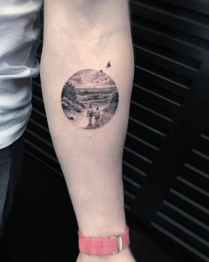 beach landscape tattoo on the left inner forearm