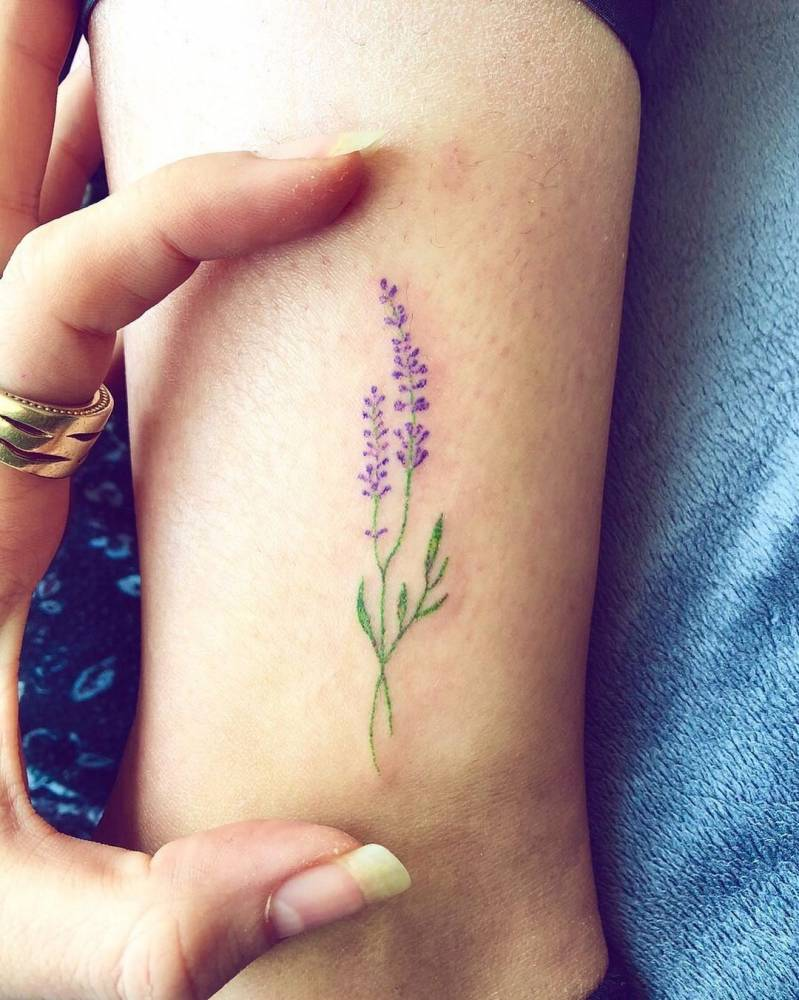 Hand poked lavender tattoo on the ankle.