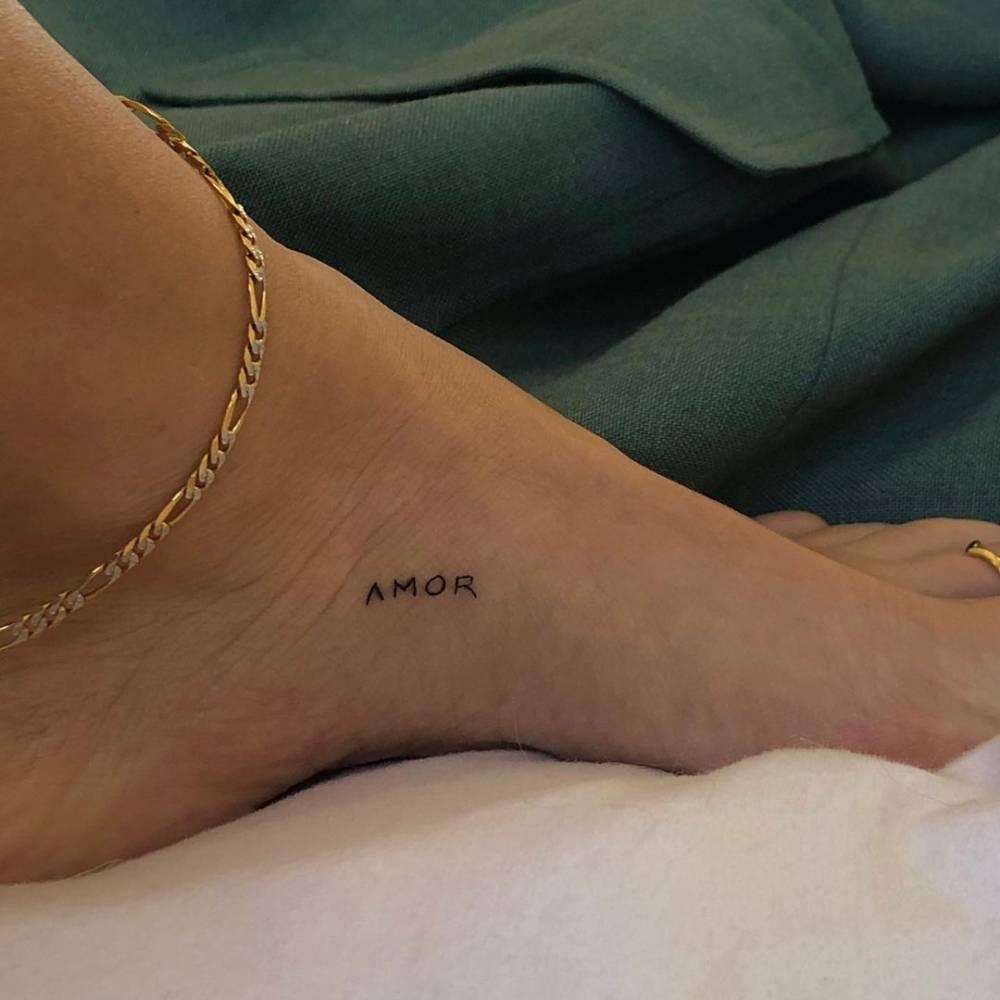 """Amor"" lettering tattoo on Janae Roberts' foot"