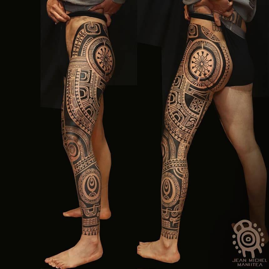 Polynesian style full leg sleeve tattoo.