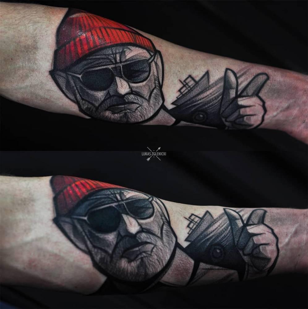 Sketch work Steve Zissou portrait tattoo on the inner forearm.