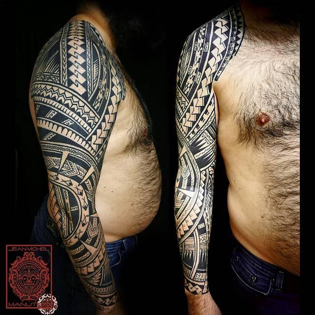 Polynesian style full sleeve tattoo.