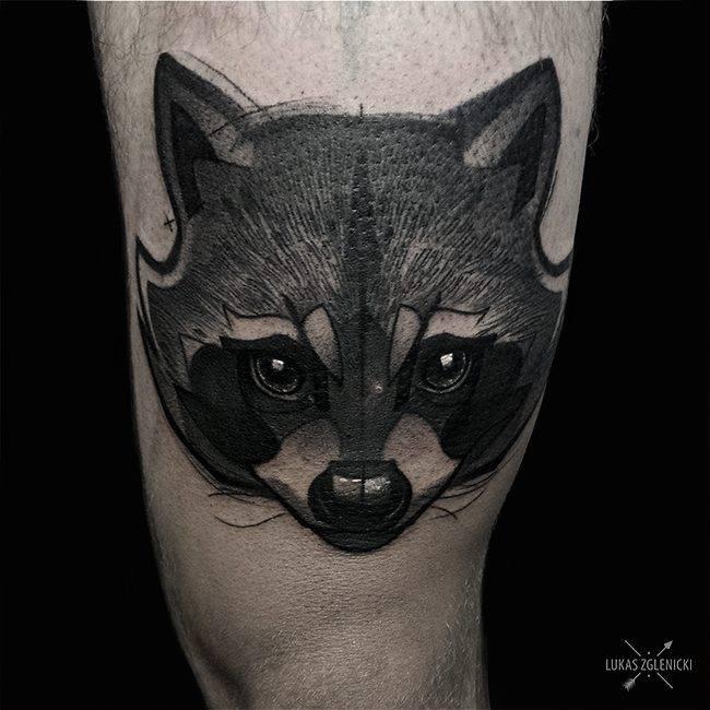 Sketch work raccoon tattoo on the inner arm.