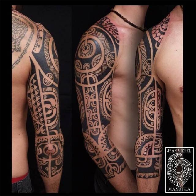 Maori style half sleeve tattoo.