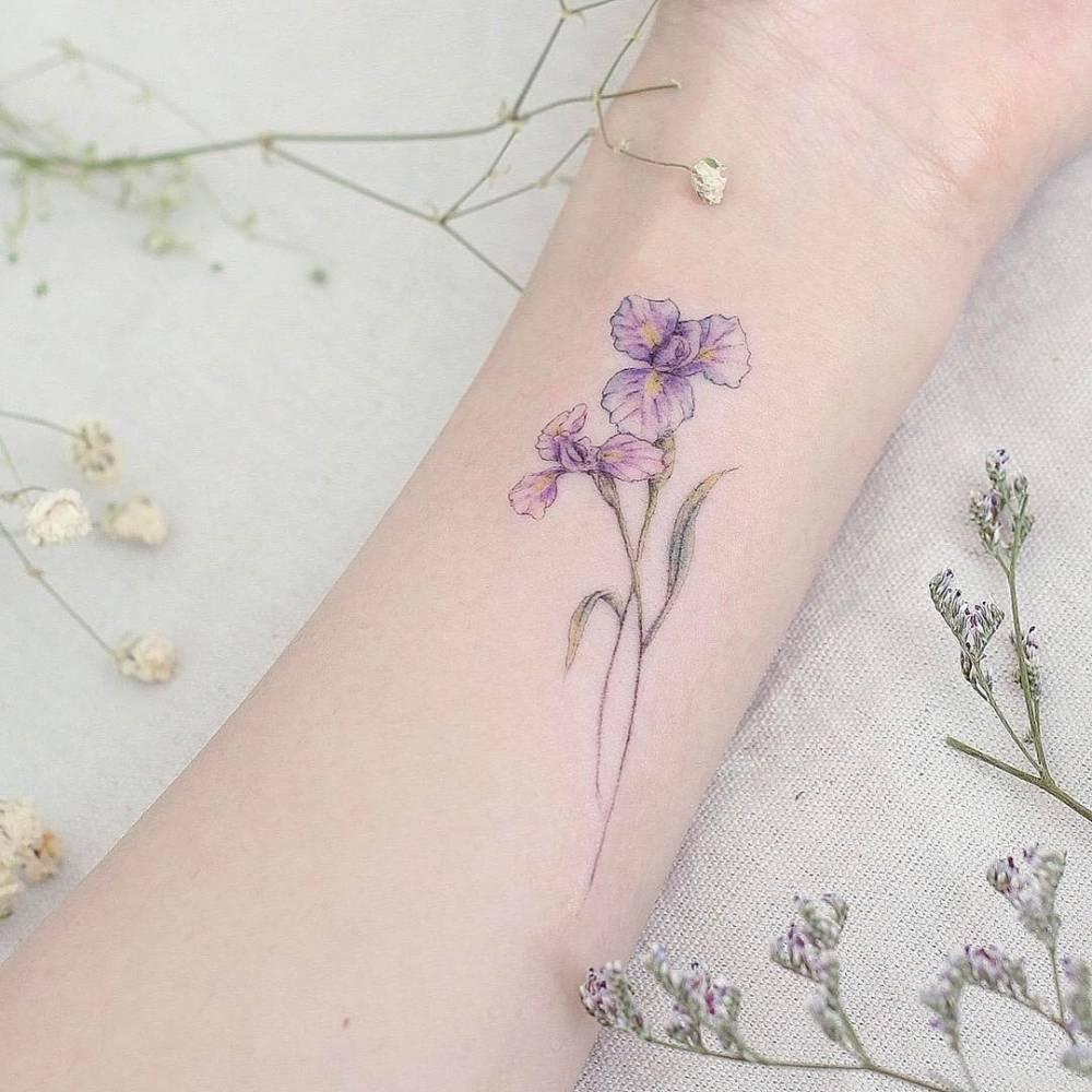 Iris flower tattoo on the inner forearm izmirmasajfo