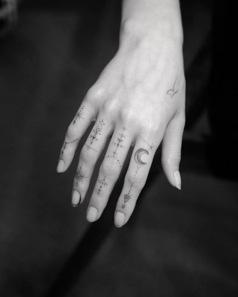 Single needle finger ornaments tattoo on Paris Berelc's hand.