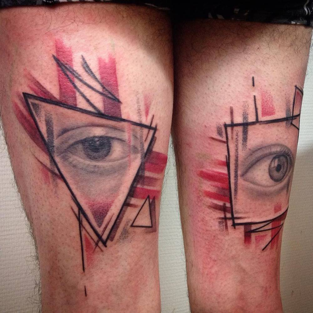 Individual matching graphic eye tattoo on the thigh.