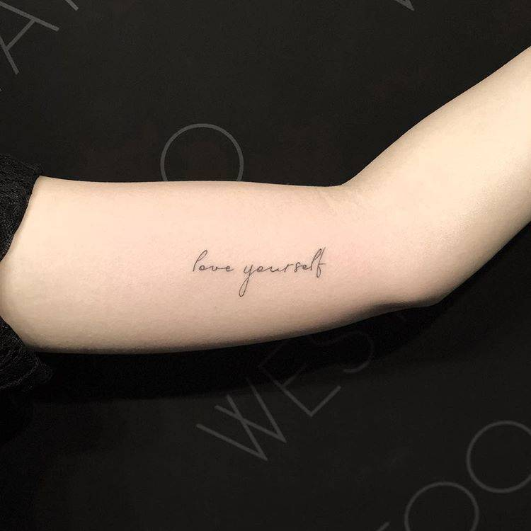"""Love Yourself"" Tattoo On The Left Inner Arm"