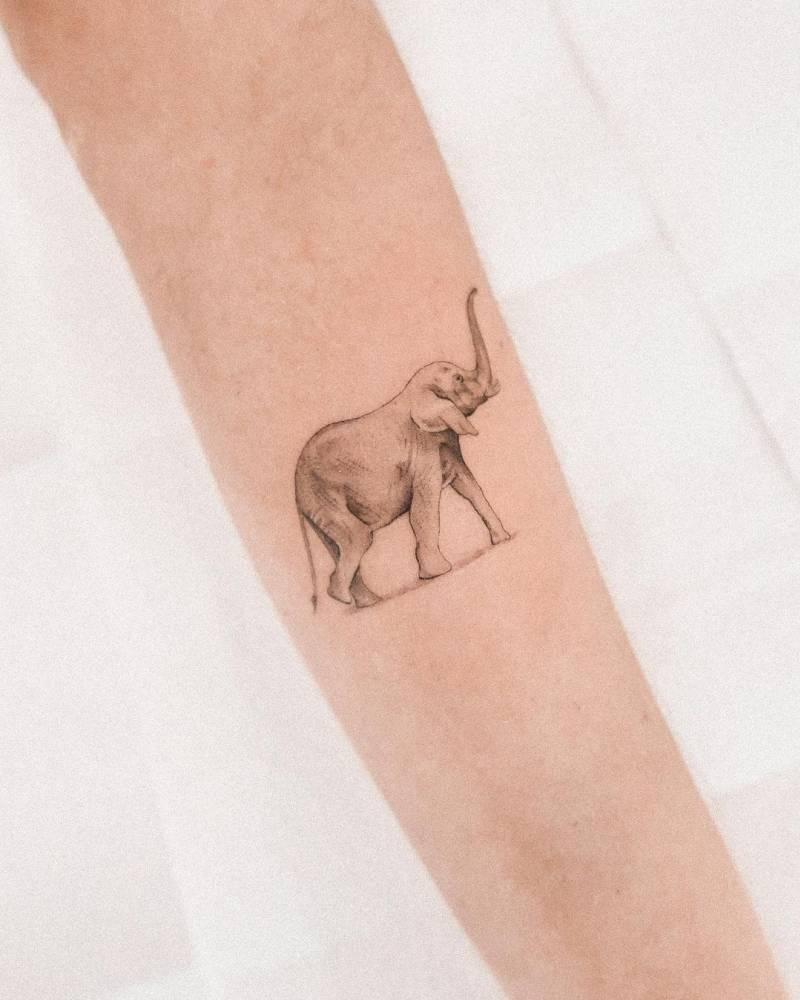 Micro-realistic elephant tattoo on the inner forearm.